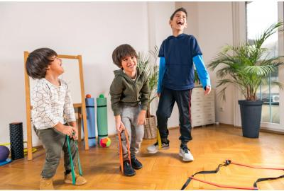 kids laughing with resistance bands