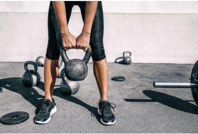 Woman holding kettlebell at the knees