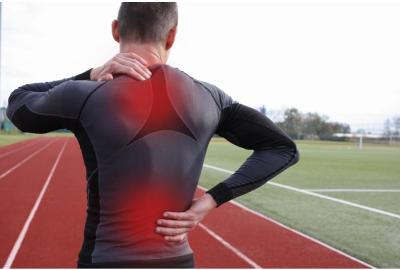 man on track with back pain