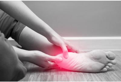 Holding the heel of the foot in pain