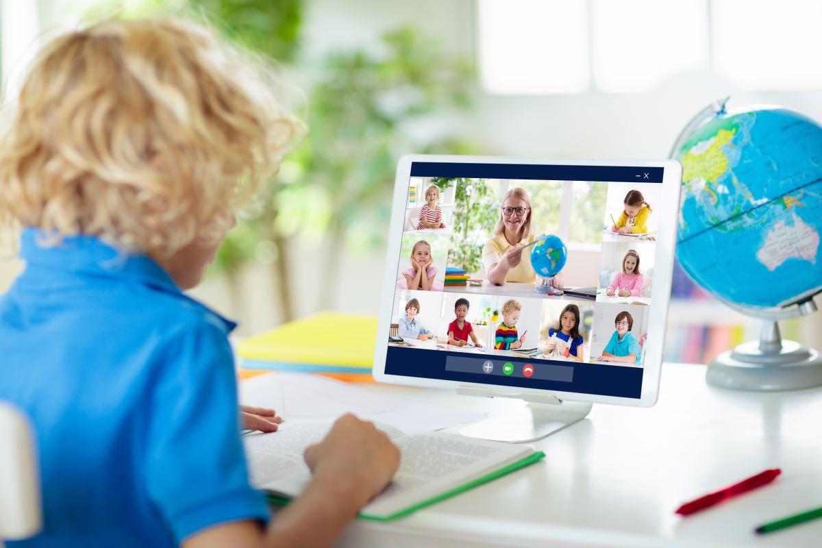little boy on computer for online class