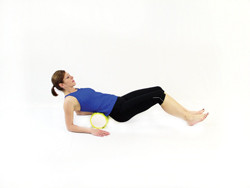 TheraBand Foam Roller in use on lower back