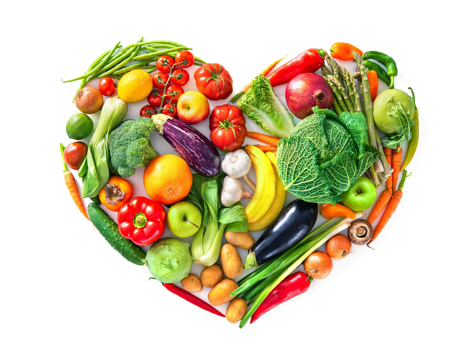 Colorful assortment of vegetables in the shape of a heart against a white background