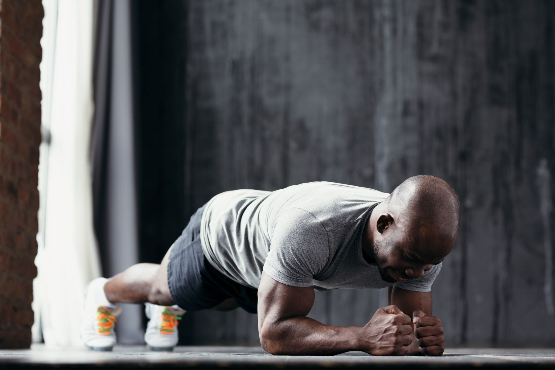 Man on exercise mat in plank position