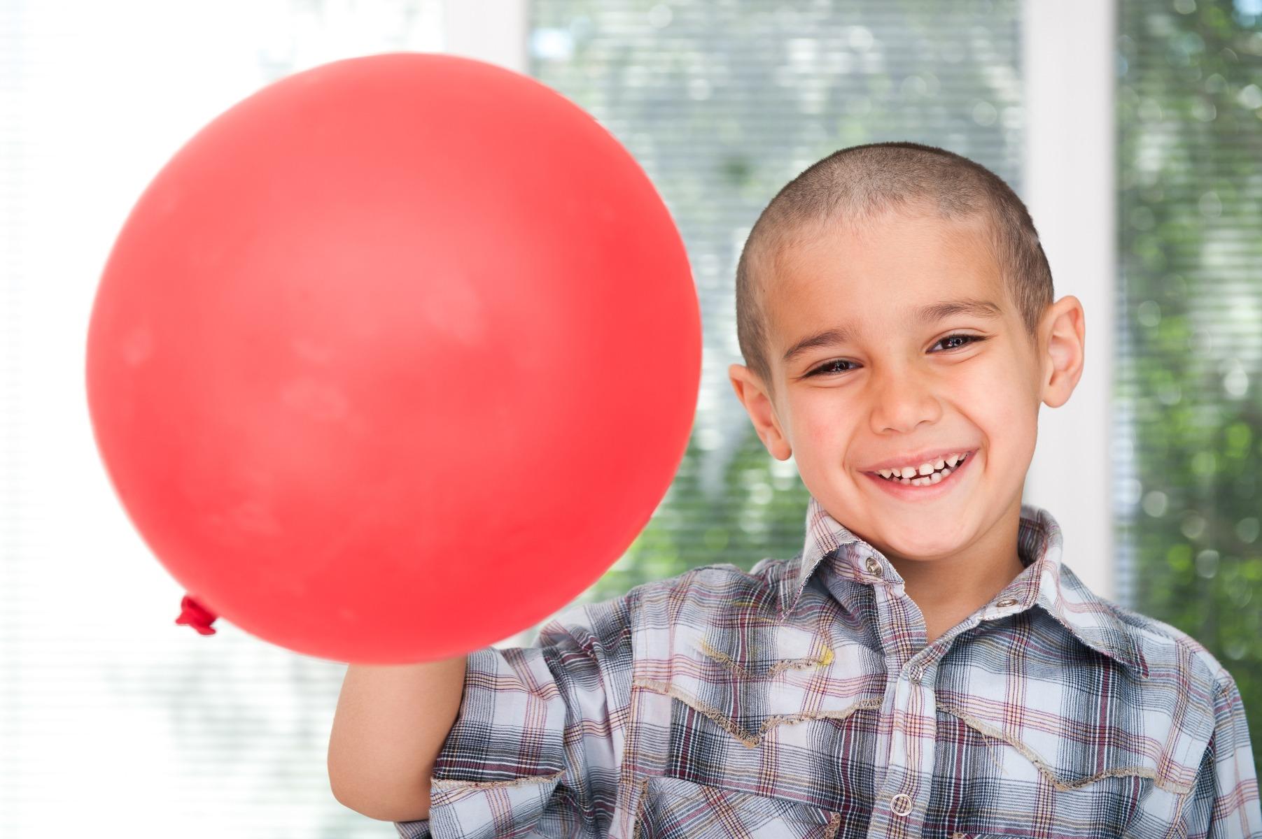 boy holding balloon