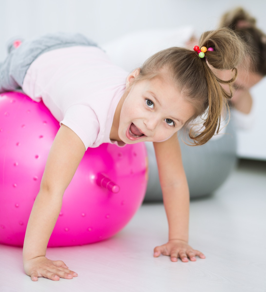 child on exercise ball