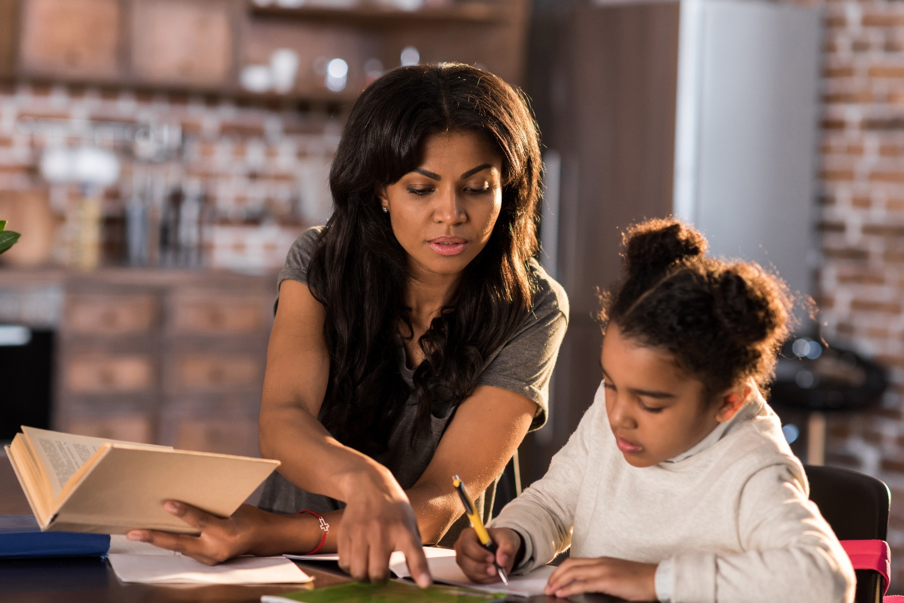 mom helping girl with school work