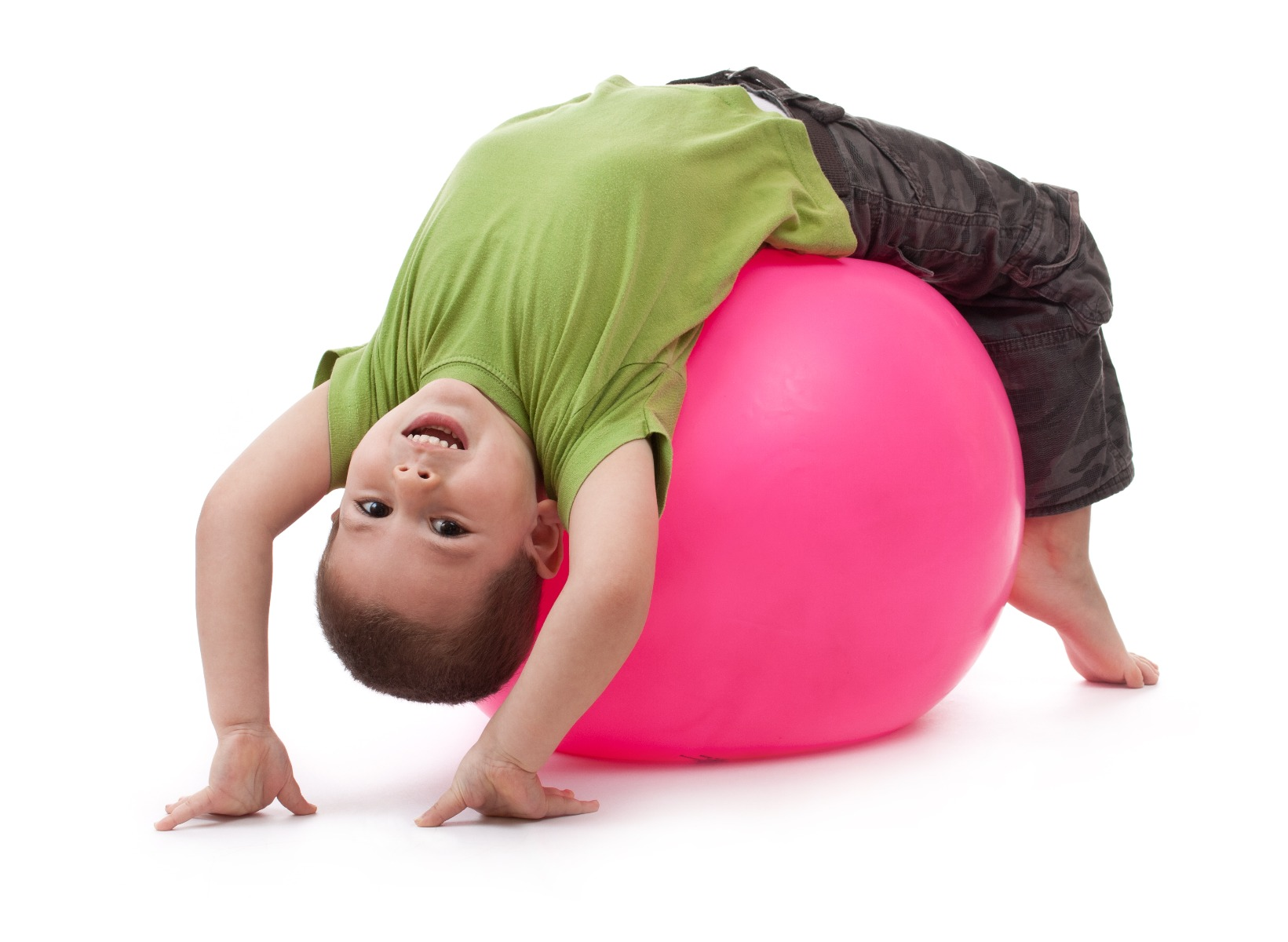 little boy doing core exercises on exercise ball